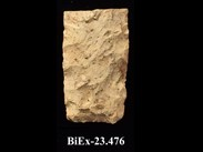 Fragment of whitish chipped stone, rectangular with sharp edges. The number BiEx-23.476 is inscribed on the bottom.