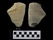 Two sides of a beige chipped stone of irregular polygonal shape. The number BiEx-23.564 is inscribed on the bottom and on the left-side face. Below the image is a photographic scale with black and white squares.